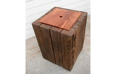 Reclaimed fence posts and black oak side table with internal shelf.