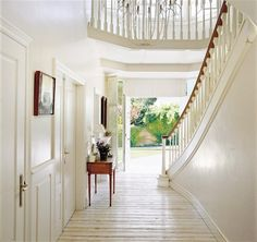 Gorgeous, sweeping entryway. Staircase & flooring are beautiful and elegant. Adore.