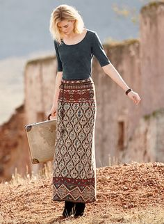 Fall's most extraordinary skirt is patterned in an intricate mix of motifs from traditional oriental rugs. Jacquard knit in vegetal dye hues of henna, stone, chambray and navy pima.