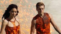 The Hunger Games: Catching Fire (from Left to Right) Katniss Everdeen (played by Jennifer Lawrence) and Peeta Mellark (played by Josh Hutcherson @jutch1992 ) at the tributes parade.  The new trailer was so good!  I saw it like 30 times.