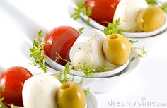 Mozzarella, cherry tomatoes and olives garnished w