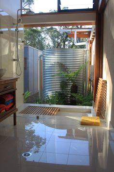 Shower floor deck over sunken tub. Very cool.
