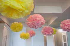 Homemade poufs made from tissue paper and string could hang from the ceiling among lanterns or on tables as table decor