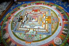 The sacred art of sand painting comes from the Tibetan Buddhist tradition (Tib: dul-tson-kyil-khor – mandala of coloured powders; 'mandala' means circle in Sanskrit). Tibetan Buddhism (7th century CE) is based on Indian Buddhism (5th century CE), and its main goals are to reach individual enlightenment, the liberation of all beings, and the development of unconditional compassion and insight wisdom.