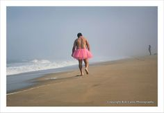 Bob Carey photographs himself in various environments while wearing a pink tutu to help fight his wife's breast cancer.