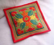 This free scented sachet from Ziva uses basic needlepoint and exposed canvas for an Art Nouveau design.