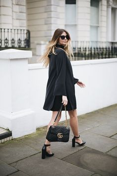 Emma Hill wears Gucci Marmont bag, black tailored trousers ...