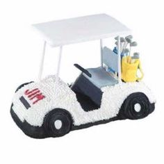 Making the Rounds Golf Cart Cake. It's baked in our 3-D Cruiser Pan with piped-icing details and golf bags fashioned from tinted Ready-to-Use White Rolled Fondant.