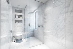 Simple Marble Bathroom with Glass Shower