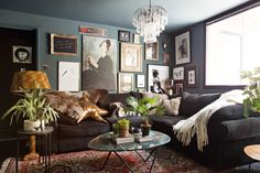Catherine Ashton has owned this 832 square feet London flat for 14 years, but only recently transformed the formerly all-white space with lots of dark and dramatic wall colors.