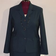 """Evan Picone Navy Pinstripe Suit Jacket size 16 Up for grabs is this suit jacket from Evan Picone. It is a size 16 and measures 26"""" from shoulder to hem and has a 46"""" bust, a 42"""" waist and 47"""" hips. This jacket is a navy blue pinstriped print and is lined. It buttons up to the neckline with a three button closure. This blazer has flap pockets on the hips. It is new with the original tag. *I also have a matching pair of dress pants for sale that are a size 18.* Evan Picone Jackets & Coats…"""