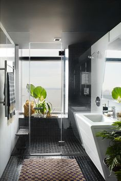 """1. Black is the New Black """"Use black to make small spaces look and feel bigger. Not only is black effortlessly chic, it also creates the illusion of a space in an otherwise cramped room,"""" Beckstedt says. 2. Mix Textures """"Using materials that are soft to the touch creates a contrast to the other hard bathroom surfaces. The resulting visual and tactile experience will be much more interesting and pleasing to the senses."""" - ELLEDecor.com"""