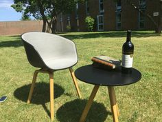 Some Danish #HAY furniture brought out to enjoy the sun one warm summer day.  The HAY AAC22 with black shell, Steel Cut Trio upholstery with the colourcode124, and oak legs. Design by Hee Welling.   Seen together with a small (Ø50x50cm) HAY Copenhague (Round Table CPH20), with black linoleum and oak legs as well. Design by brothers Bourollec.  Perfect example of Nordic design, and good inspiration for homedecor and interiordesign