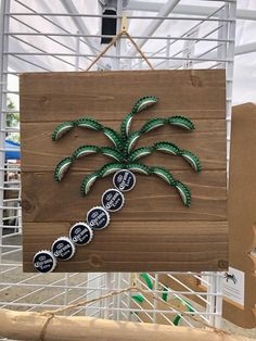 Excited to share this item from my shop: Mini Bottle Cap Palm Tree Dark Stain Pallet Super Cute and Simple Palm perfect for small spaces or beach themed decor, patios bars etc Diy Bottle Cap Crafts, Beer Cap Crafts, Bottle Cap Projects, Beer Cap Art, Beer Bottle Caps, Beer Caps, Beer Bottles, Bottle Cap Coasters, Bottle Top Art