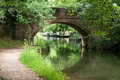 The Basingstoke Canal. It runs for 32 miles from Greywell Village in Hampshire to Woodham in Surrey.
