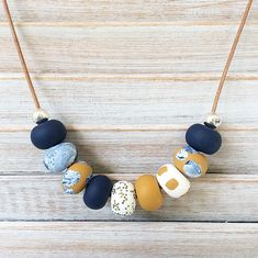 Navy, white and mustard necklace, polymer clay necklace, long beaded necklace, polymer clay jewellery handmade by rubybluejewels by Rubybluejewels on Etsy https://www.etsy.com/au/listing/610746547/navy-white-and-mustard-necklace-polymer