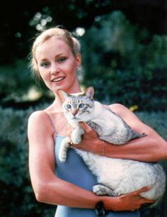 A very young Jessica Lange and a very chubby cross-eyed kitty.