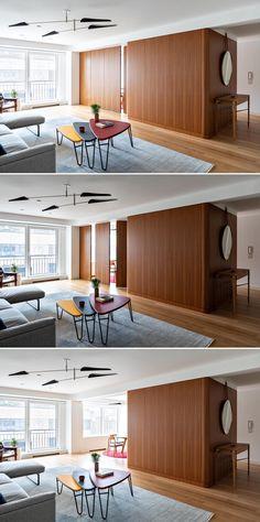 Wood Panel Walls, Wood Paneling, Wood Wall, Large Bookshelves, Folding Walls, Hidden Tv, New York City Apartment, Built In Bench, Open Plan Living