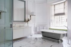 Luxury bathroom ideas   London home designed by Francis Sultana and architect Thomas Croft; the sink and tub fittings are by Grohe, and the floor is statuary marble   #luxuryideas #bathroomideas #masterbathrooms