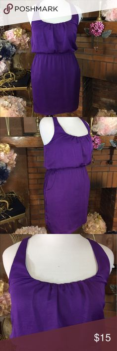 City Triangles purple razor back dress City Triangles purple razor back dress with elastic waist and pockets. Size M. Approx measurements are 36 inch bust and 30 inch stretchy waist 35 inches long. Dress is fully lined and 100% polyester. Previously owned but in good condition free of stains and defects. Please check out all pictures. Read full description of the items. To ensure a happy shopping experience, please ask me any questions. City Triangles Dresses Mini
