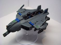 Tau Bork an Sept Piranha/Assassin Stealth-Strike Skimmer.