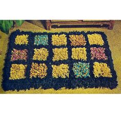 Need a crochet rug pattern for a small space.   Here's a great choice in 5 colors and a dark order that can be made up as pastel, bold or mellow as you might like.   It's 20 x 36 inches.