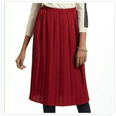 "Anthropologie Red With Black Polka Dot Skirt Beautiful pleated knee length skirt from Karen Walker for Anthropologie. Easy pull on construction with elasticized waist. Length 28"" waist 13 1/2"". Unlined. 100% Polyester. Anthropologie Skirts"