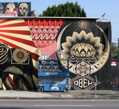 Shepard Fairey // Los Angeles  L.A. street artist Shepard Fairey (OBEY) hits Melrose Avenue, creating this pop-psychedelic mural on the exterior of De La Barracuda.