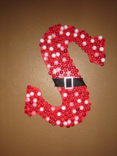 """""""S"""" is for Sweeney and Santa !!  Large Wood Letter; Painted Red; Added Red and White Flat Marbles; Finished off with a Santa Belt taken off a $1.oo store Stocking. - Jackie gave me this idea.  Turned out really nice !"""
