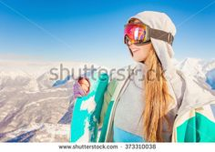 Snowboard. Female snowboarder on the background of high snow capped Alps in Swiss