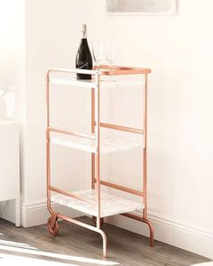 This SUNNERSTA utility cart was hacked using marble contact paper and rose gold spray paint.