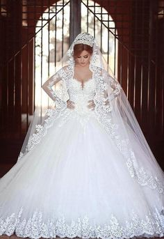 """""""Divorce isn't such a tragedy. A tragedy is staying in an unhappy marriage, teaching everyone around you the wrong things about love. Nobody ever died of divorce."""" ― Jennifer Weiner, Fly Away Home - Sweetgirl White Lace Wedding Dresses with Long Sleeve Royal Train"""