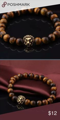 🆕Tiger Eye Stone With Gold Lion Charm This beautiful Unisex bracelet will be great for layering including wear with a watch. Evolve Always Accessories Jewelry