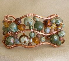 No tutorial that I found, but great inspiration! Copper and Rhyolite bracelet, very cool. Jewelry making tips, tricks & inspiration on this site. Amber Jewelry, Copper Jewelry, Wire Jewelry, Jewelry Crafts, Jewelry Art, Beaded Jewelry, Jewelery, Jewelry Design, Fashion Jewelry