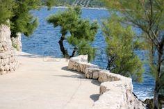 walking trail next to the blue sea, Croatia