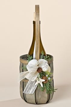 Grey Wine Basket with Faux Juniper, Pine Cones, an Ivory Bow and a Mud Starfish