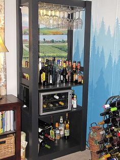 Transform a thrift-store bookcase into a bar by painting & adding a wine fridge.