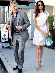 Amal Clooney in ivory pleated dress