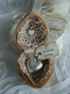 Silver heart in nut shell with lace.