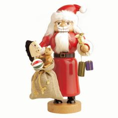 Santa Claus German Nutcracker with Toys is made by KWO in Olbernhau Germany.