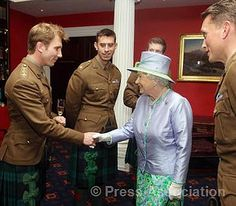 The Queen, Royal Colonel, meets members of The Argyll and Sutherland Highlanders, 5th Battalion The Royal Regiment of Scotland during lunch at the Caledonian Club, London, 30 May 2012.