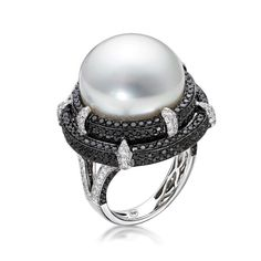 Alba Ring by BELPEARL. The Alba ring features a 16mm button shaped white South Sea pearl in a tier of black diamonds set in black rhodium punctuated by white diamond highlights. Set in 18kt white gold.