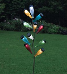 According to ancient folklore, evil spirits are attracted to colorful glass bottles gleaming in the twilight, and become trapped inside only to be vaporized by the first sunbeams of the morning. Today, our metal bottle tree outdoor accent is a unique and fun way to design your own sculpture. A great way to repurpose your soda or wine bottles, you can change them out periodically for a rotating display or use it to communicate special occasions. Metal bottle tree holds up to 11 bottles.
