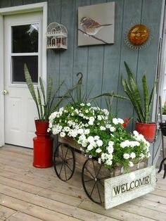 rustic flower displays along the workshop and backyard garden, container gardening, flowers, gardening, outdoor living, repurposing upcycling