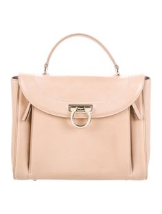 #FERRAGAMO | From the Spring/Summer 2018 Collection. Beige leather Salvatore Ferragamo Sofia Rainbow bag with gold-tone hardware, adjustable shoulder strap, single flat top handle, dual zip expansions at front face featuring purple leather accents, single slit pocket at exterior, pale pink leather interior, single pocket at interior wall with zip closure and flap with Gancio-lock closure at front. Includes tags and dust bag. Shop authentic designer handbags by Salvatore Ferragamo at The…