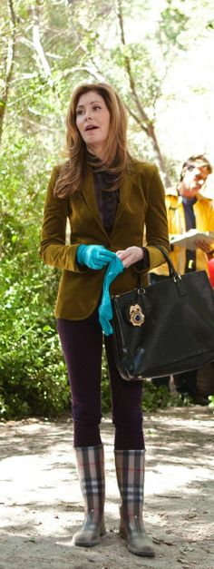 dr megan hunt (body of proof) favours great tailoring such as this green velvet Gucci jacket, structured handbags and mega high heels (or here, burberry rainboots)
