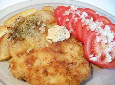 Polish First Courses — top 27 first courses from Poland (Polish schnitzel - kotlet schabowy with tomato and potatoes fried on oil)