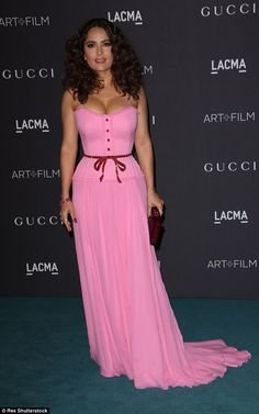 Barbie girl: Salma Hayek, 49, showcased her ample assets in a figure hugging pink gown as she attended the 5th Annual LACMA Film + Art Gala on Saturday