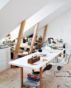 That's how a creative space should be. Love that metal cabinet, it's perfect for paper storage.