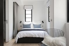 A clean and serene bedroom in a stylish studio apartment in Hong Kong